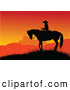 Clip Art of a Silhouetted Cowboy on Horseback Against a Warm Orange Sunset by Pushkin